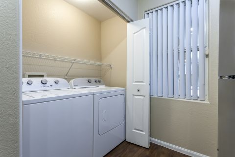 Laundry Room at Camden Crown Valley Apartments in Mission Viejo, CA