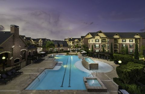 Resort-style Pool with Lap Lanes at Camden Cypress Creek Apartments in Cypress, TX