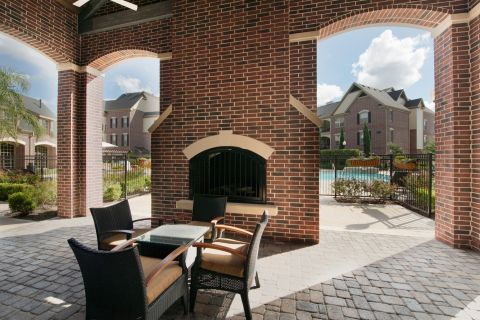 Outdoor Fireplace at Camden Cypress Creek Apartments in Cypress, TX