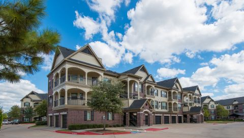 Wrap-around Balconies at Camden Cypress Creek Apartments in Cypress, TX