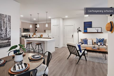 Contemporary dining and living area at Camden Cypress Creek Apartments in Cypress, TX