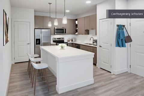 Contemporary Kitchen with stainless steel appliances at Camden Cypress Creek Apartments in Cypress, TX