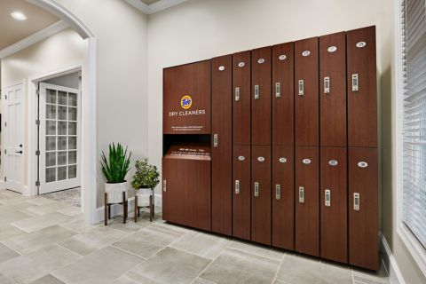 Dry cleaning lockers at Camden Cypress Creek Apartments in Cypress, TX