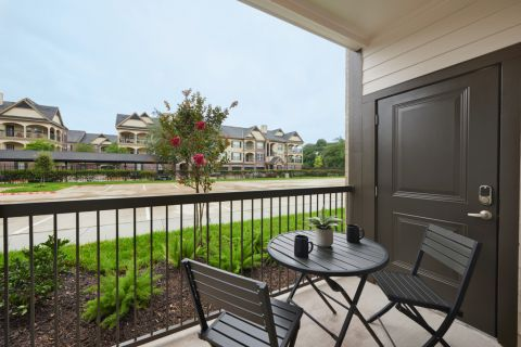 Patio at Camden Cypress Creek Apartments in Cypress, TX