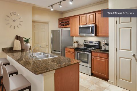Traditional Kitchen with stainless steel appliances at Camden Cypress Creek Apartments in Cypress, TX
