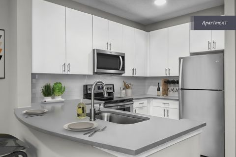 Apartment Kitchen with stainless steel appliances at Camden Deerfield Apartments in Alpharetta, GA