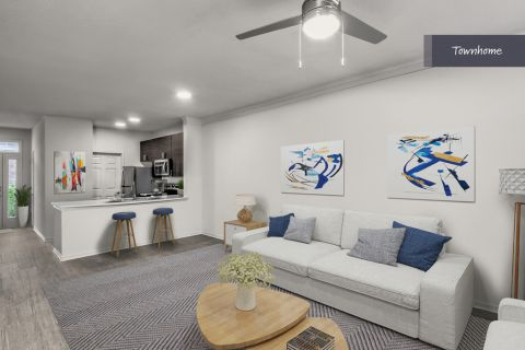 Townhome Living Room at Camden Deerfield Apartments in Alpharetta, GA