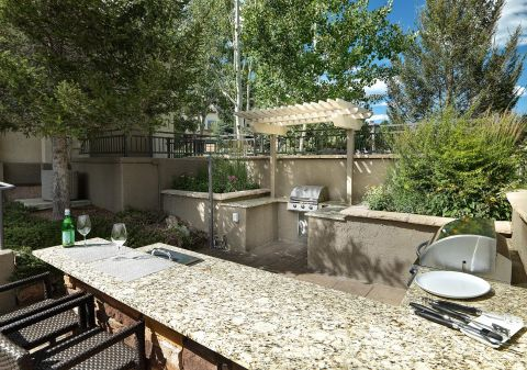 Outdoor Kitchen with Grills at Camden Denver West Apartments in Golden, CO