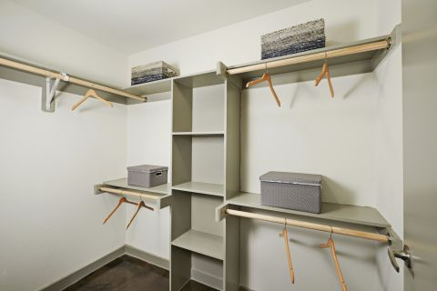 Closet with Concrete Flooring at Camden Design District Apartments in Dallas, TX