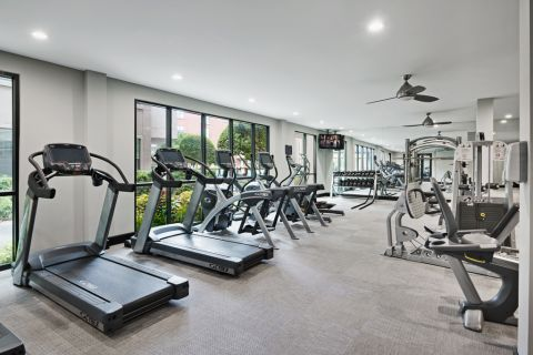 Fitness Center with Cardio and Strength Training Equipment at Camden Design District Apartments in Dallas, TX