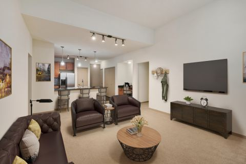 Living Room with Carpet at Camden Design District Apartments in Dallas, TX