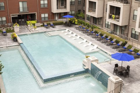 In-Water Pool Loungers at Camden Design District Apartments in Dallas, TX