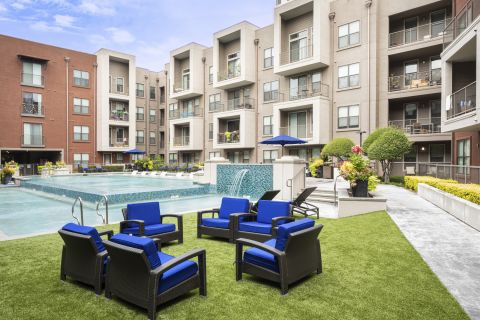 Seating at the Resort-Style Pool at Camden Design District Apartments in Dallas, TX