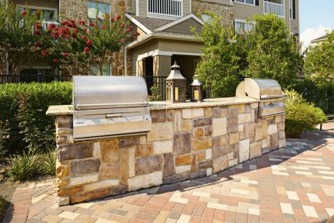 Outdoor Dining Area with Grills at Camden Downs at Cinco Ranch Apartments in Katy, TX