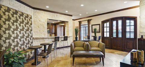 Social Lounge with Kitchen and Entertaining Space at Camden Downs at Cinco Ranch Apartments in Katy, TX