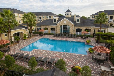 Resort-style Pool and Outdoor Lounge at Camden Downs at Cinco Ranch Apartments in Katy, TX