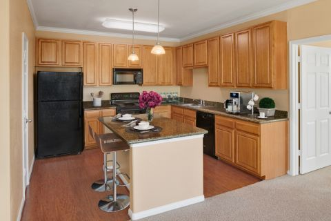 Kitchen with island at Camden Downs at Cinco Ranch Apartments in Katy, TX