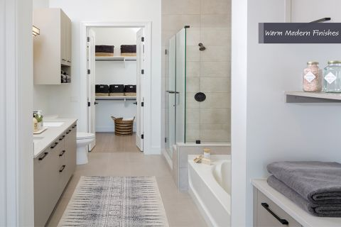 Large bathroom in Warm Modern Finish Scheme at Camden Downtown Houston Apartments in Houston, Texas
