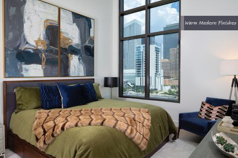 Bedroom in Warm Modern Finish Scheme at Camden Downtown Houston Apartments in Houston, Texas