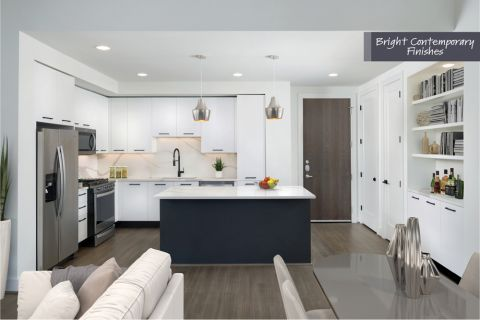 Kitchen with stainless steel appliances with bright contemporary finish scheme at Camden Downtown Houston Apartments in Houston, Texas