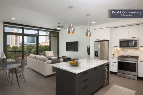Kitchen and Living Room with bright contemporary finish scheme at Camden Downtown Houston Apartments in Houston, Texas