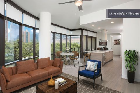 Living and Dining Area in Warm Modern Finish Scheme at Camden Downtown Houston Apartments in Houston, Texas