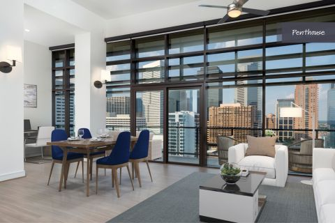 Penthouse Living Room and Dining Area at Camden Downtown Houston Apartments in Houston, Texas