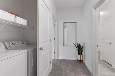 Laundry room at Camden Dulles Station Apartments in Herndon, VA