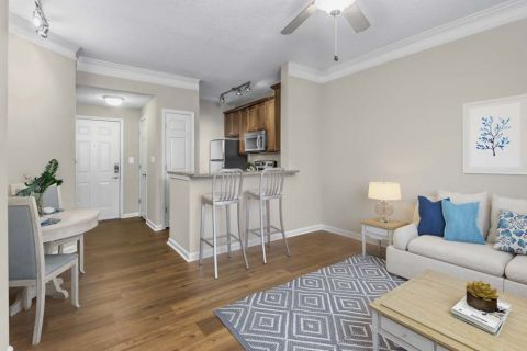 Dining and Living Room at Camden Dunwoody Apartments in Dunwoody, GA
