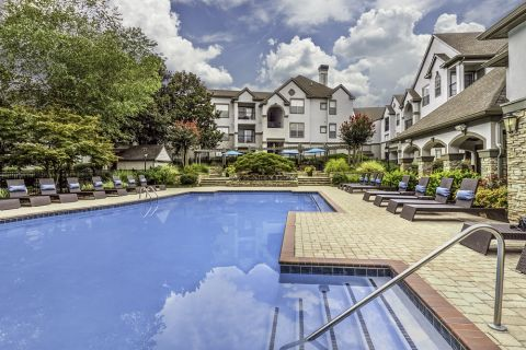 Resort-style swimming pool at Camden Dunwoody Apartments in Dunwoody, GA