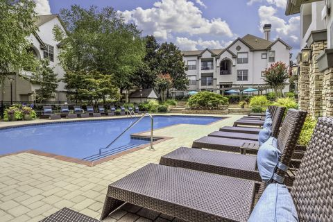 Lounge Seating Area at the Swimming Pool at Camden Dunwoody Apartments in Dunwoody, GA