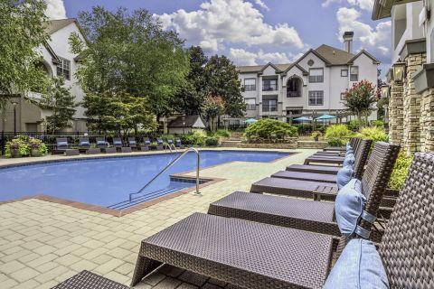 Lounge Seating Area at the Swimming Pool at Camden Dunwoody Apartments in Dunwoody, GA