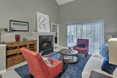 Living Room with Fireplace at Camden Fair Lakes Apartments in Fairfax, VA