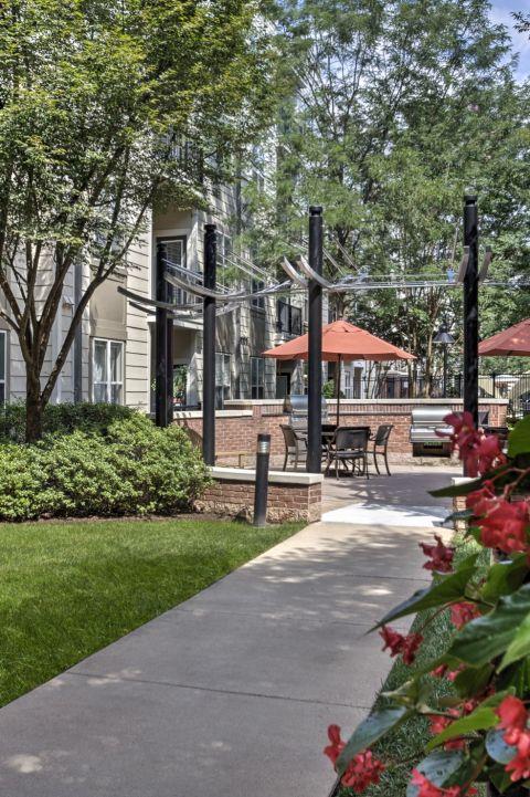 Courtyards with Outdoor Grills at Camden Fairfax Corner Apartments in Fairfax, VA