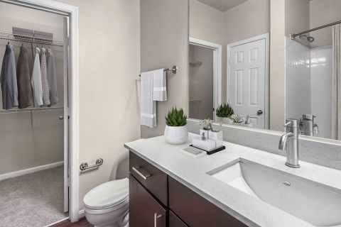 Bathroom with Walk-In Closet Kitchen at Camden Fallsgrove Apartments in Rockville, MD