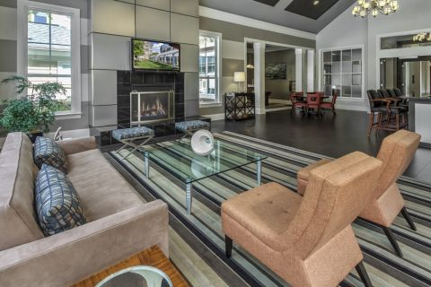 Resident Lounge with Fireplace and Large Screen TV at Camden Fallsgrove Apartments in Rockville, MD