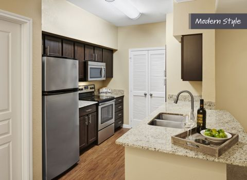 Modern Style Kitchen with Venetian Gold Granite Counters at Camden Farmers Market Apartments in Dallas, TX