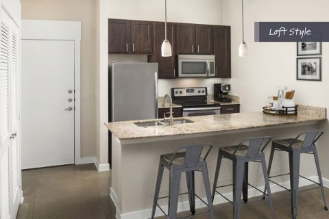 Loft Style Kitchen at Camden Farmers Market Apartments in Dallas, TX