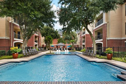 Resort-Style Swimming Pool at Camden Farmers Market Apartments in Dallas, TX