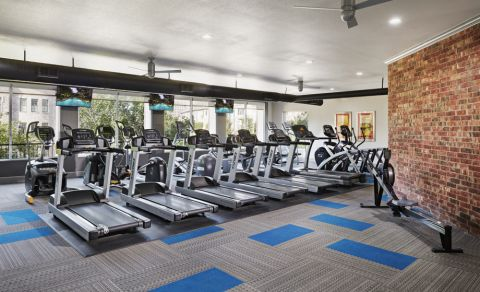 Fitness Center with cardio equipment at Camden Farmers Market Apartments in Dallas, TX