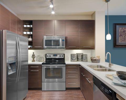 Kitchen with stainless steel appliances at Camden Flatirons Apartments in Interlocken, CO