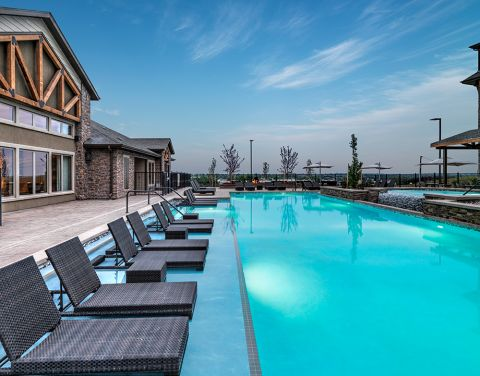 Swimming Pool with Lounge Chairs at Camden Flatirons Apartments in Interlocken, CO