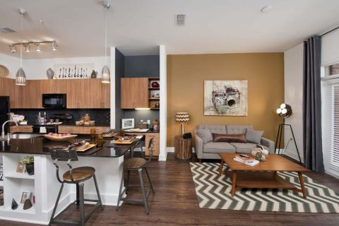 Living Room and Kitchen at Camden Fourth Ward Apartments in Atlanta, GA