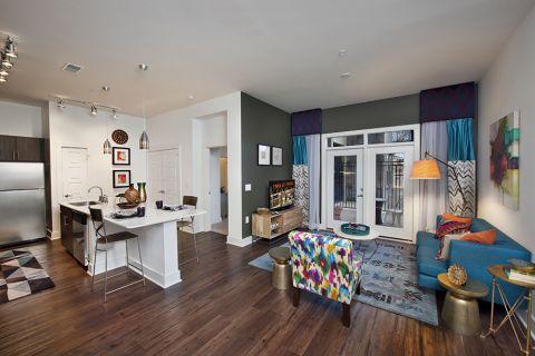 Living Room with Private Balcony at Camden Fourth Ward Apartments in Atlanta, GA