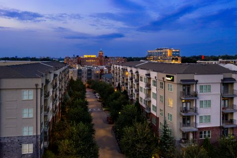 Exterior at twilight at Camden Fourth Ward Apartments in Atlanta, GA