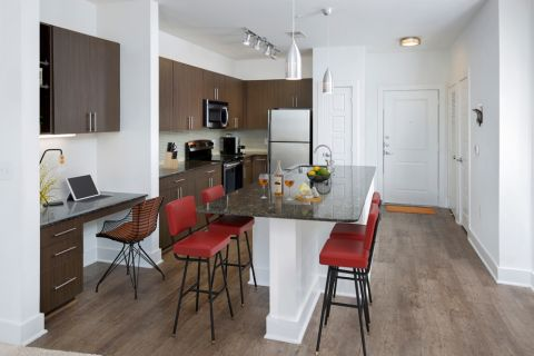Kitchen with home office space at Camden Fourth Ward Apartments in Atlanta, GA