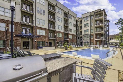 Grilling Area at Pool at Camden Fourth Ward Apartments in Atlanta, GA
