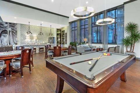 Resident lounge with billiards table at Camden Gallery Apartments in Charlotte, NC