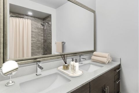 Bathroom with double-sink vanity at Camden Gallery Apartments in Charlotte, NC