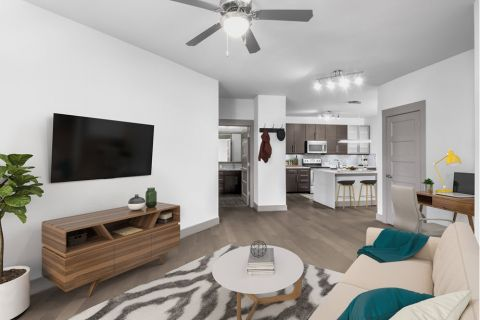 Open-concept living room with work from home space at Camden Gallery Apartments in Charlotte, NC